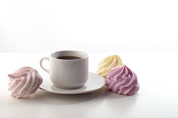cup of coffee and meringue on a white background