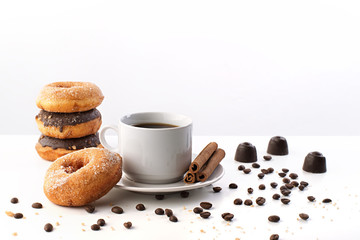 cup of coffee, chocolates, donuts, cinnamon