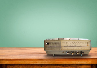 Old retro radio on table with vintage green pastel background