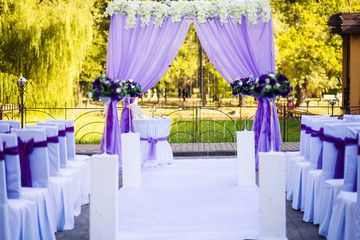 wedding ceremony decorated violet silk