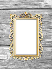 Close-up of one golden picture frame on weathered monochrome wooden boards background