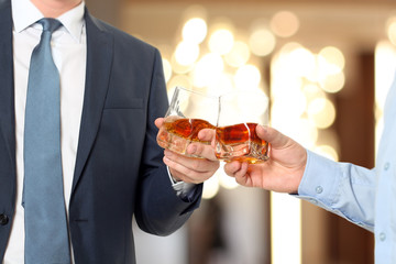 Holiday Event  business people cheering each other with Whisky