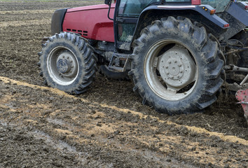 Close up of agriculture tractor in cultivating field
