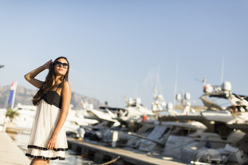 Young woman in the marina