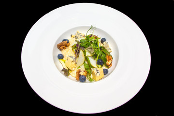 Risotto with Gorgonzola, walnuts, blueberries and sprouts of gre