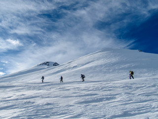 Ascent of a group of climbers on the snowy mountain