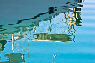 Reflection of a ship at morning as colorful picturesque abstraction