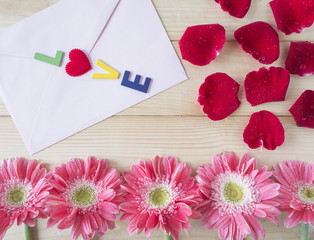Red roses, pink flower and pink envelope 2