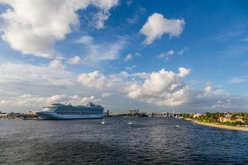 Cruise Ship by Bridge Under Sky