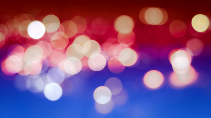 Abstract blur bokeh background with the colors of the American flag, real defocused lights.