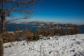 Winter snowy landscape with lake Plastira, Fesalia, Greece