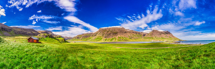 Panorama of mountains with small cottage, Iceland