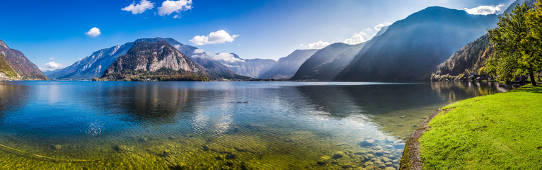 Spoed Foto op Canvas Bergen Panorama of crystal clear mountain lake in Alps