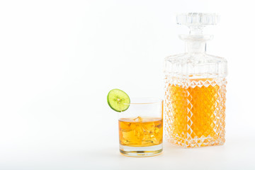 glass and bottle of whiskey on a white background, for semple text