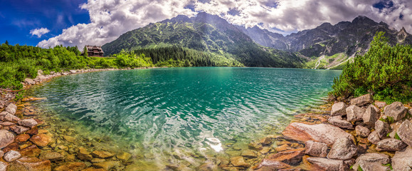 Panorama of lake in the Tatra mountains at sunrise