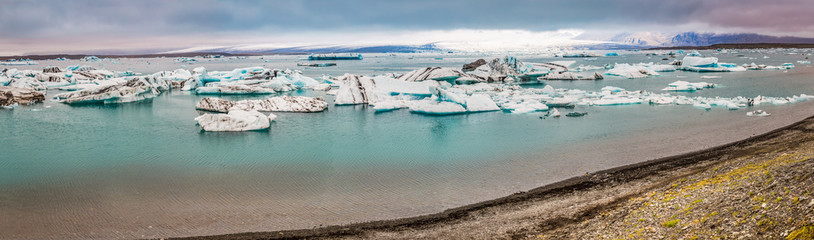 Panorama of lake full of icebergs in Iceland
