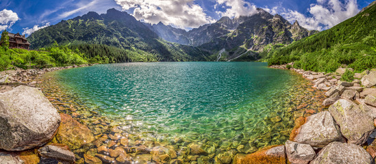 Panorama of lake in the middle of the Tatra mountains at dawn