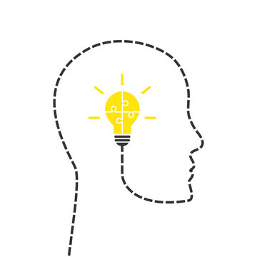 Solution concept . Head and lightbulb made of yellow puzzle pieces.