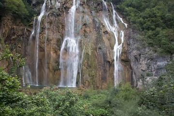 Beautiful waterfalls among green mountains