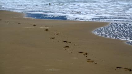 Feet prints on beautiful beach