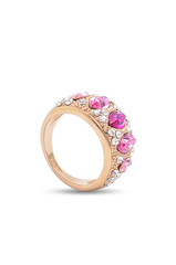 gold ring with pink stones on a white background