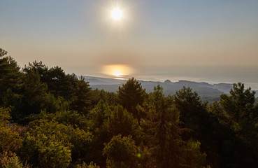 Dawn over the sea - a view from the mountain over the wood