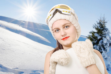 portrait of a happy young girl snowboarding with goggles