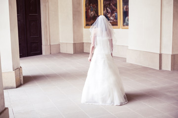 bride decides whether to enter the door