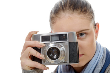 young photographer woman with a vintage camera