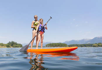 Paddle boarding on scenic mountain lake low angle view