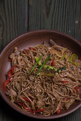 Buckwheat noodles with beef into a bowl, Thai