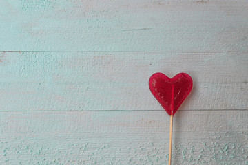 Valentines day candy heart on wooden table