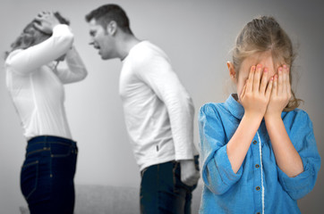 Parents quarreling at home, child is crying.