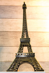Souvenir Eiffel Tower isolated on wood pattern background.