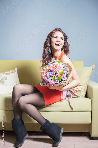 """Beautiful happy woman received a flower bouquet of tulips ..."