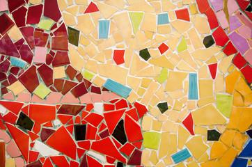 wall floor tiled with broken tiles