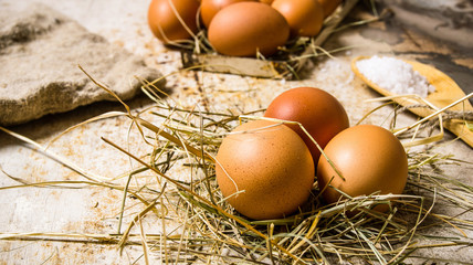 Eggs in the hay .On rustic background.