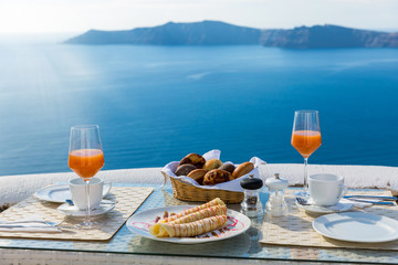 Breakfast at a table overlooking the sea