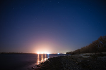 Night shore and barge lights