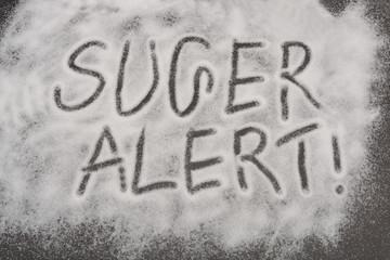 Sugar Alert warning written on crystal background