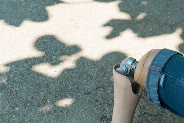 Close up of Artificial legs under tree shadow