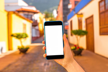 Phone on the colorful town background