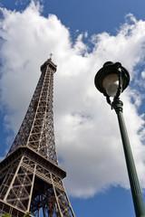 tour eiffel against cloudy sky