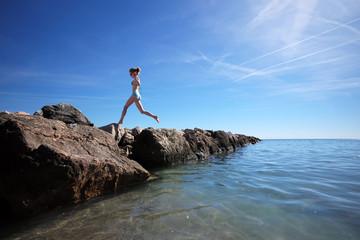 Girl exercising at seashore