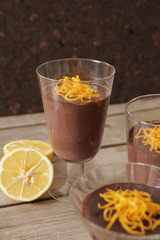 chocolate mousse with orange chips on a dark background