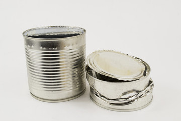 a pair of crumpled cans