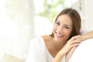 Beauty woman with white smile at home Wall mural