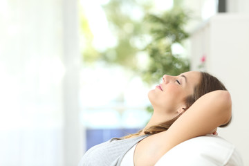 Woman relaxing lying on a couch at home Fotomurais
