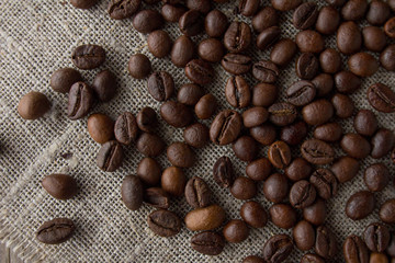 Coffee beans on linen top view