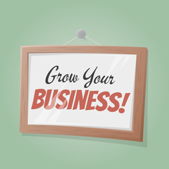 grow your business text in a picture on the wall